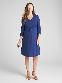 Maternity solid three-quarter sleeve wrap dress