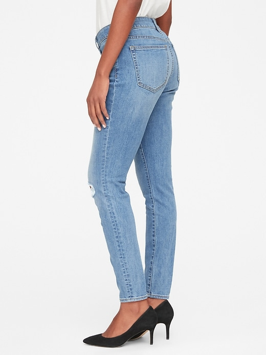 Mid Rise Curvy True Skinny Jeans with Distressed Detail